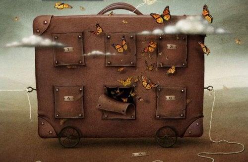 Koffer-und-Schmetterlinge symbolisieren das Leben