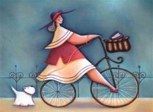 Frau mit Hund auf dem Rad sagt ich liebe mich