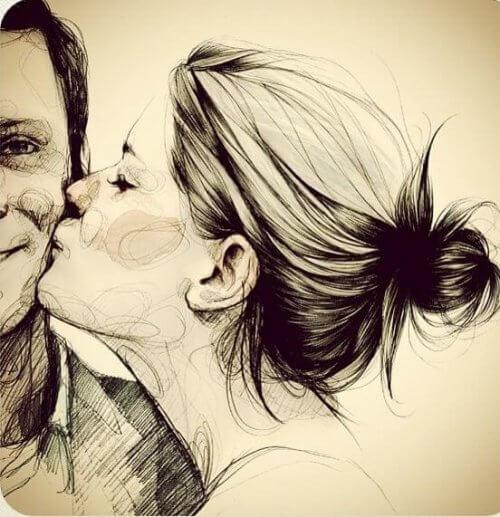 Frau küsst Mann mit Liebe