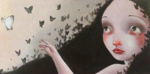 Frau mit Schmetterlingen verzeihen