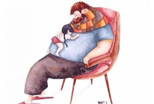 Vater mit Kind im Sessel