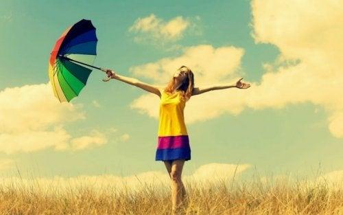 die Bedeutung der Farben, Frau mit buntem Regenschirm