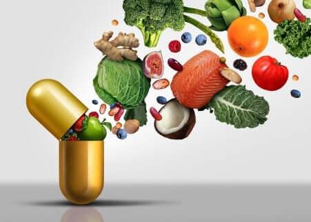 Kapsel schluckt fett- und wasserlösliche Vitamine